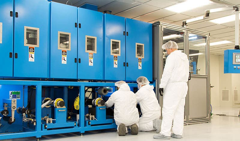 Workers examine a coater, equipment used in development of solid-state battery cells at Solid Power's pilot-production facility in Louisville, Colorado in December 2018.Solid Power Inc.